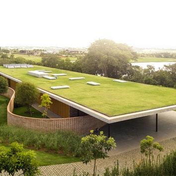 Дом с лужайкой на крыше от Studio MK27