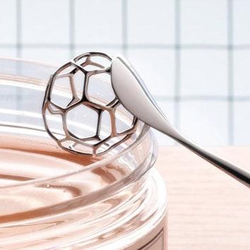 Металлическая ложка для меда
